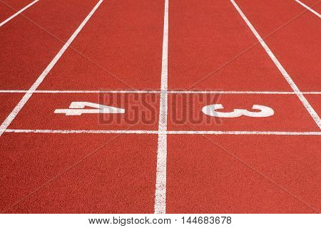 Running track with the numbers three and four