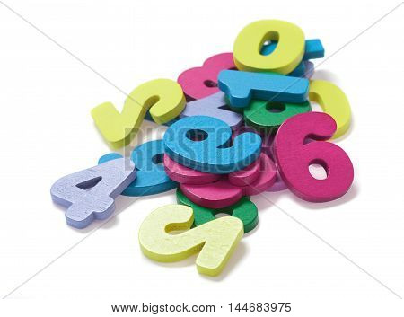 Pile of multicolored digits on white background