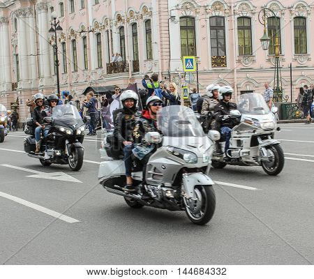 St. Petersburg, Russia - 13 August, Couples bikers on motorcycles,13 August, 2016. The annual International Motor Festival Harley Davidson in St. Petersburg.