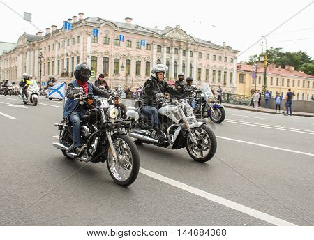 St. Petersburg, Russia - 13 August, Bikers with flags in the streets,13 August, 2016. The annual International Motor Festival Harley Davidson in St. Petersburg.