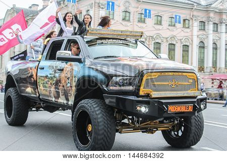 St. Petersburg, Russia - 13 August, A group of girls on a large SUV,13 August, 2016. The annual International Motor Festival Harley Davidson in St. Petersburg.