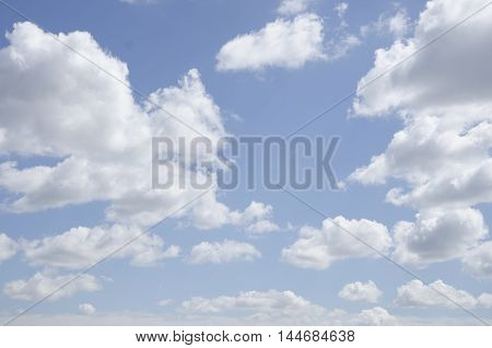 Blue sky with clouds. Summer sky. Day sky