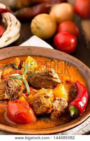 Goulash in ceramic plate closeup. Traditional hungarian meal.
