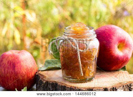Jar of apple preserves outdoor shot on grass background