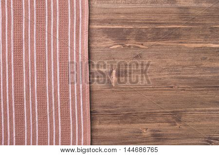 Kitchen towel from left side wooden table top view