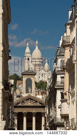 The basilica Sacre Coeur and Notre Dame de Lorette church in the background Paris France.