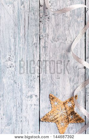 Light blue painted wooden texture with Christmas decoration in the shape of a star