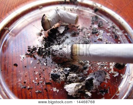 Lit Cigarette In The Ashtray