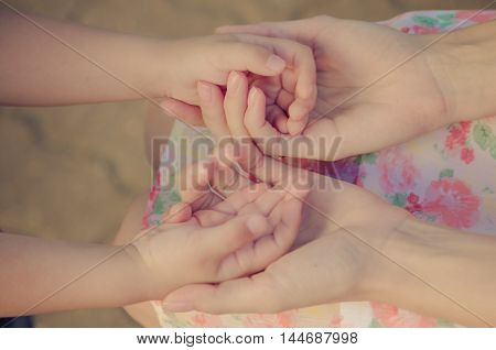 The child holds mum by the hand (vintage)