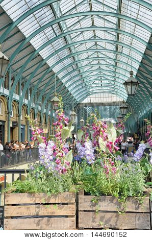 Covent Garden London England United Kingdom - August 16 2016: Piazza Convent Garden with Flowers in Foreground in portrait aspect