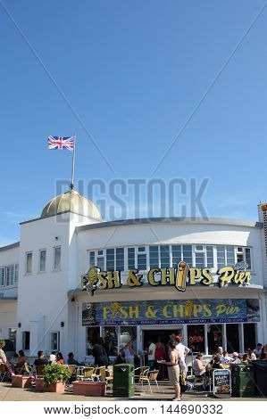 Clacton on Sea United Kingdom - August 26 2016: Fish and Chip shop advertised on Clacton Pier in portrait aspect