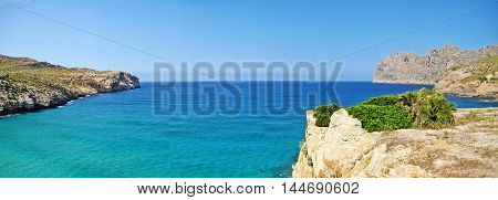 Ocean view panorama - turquoise mediterranean sea bay surrounded by mountains