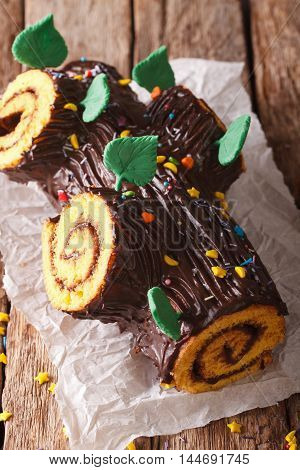 Christmas Chocolate Yule Log Cake On The Table. Vertical