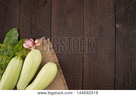 Courgettes on an old wooden table. Top view.