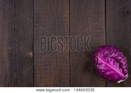 red cabbage on the old wooden table. Top view.