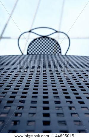 The lines and the intersection of figure and table wicker chairs metal