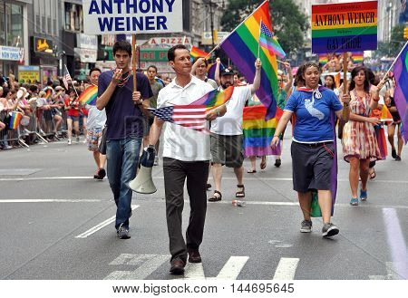 New York City - June 26 2010: Former U. S. Congressman Anthony Weiner marching in the 2010 Gay Pride Parade on Fifth Avenue