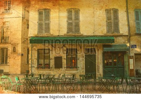Sidewalk cafe in Paris in old-fashioned sepia tone texture