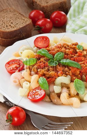Pasta bolognese sauce with cherry tomato and basil leaf
