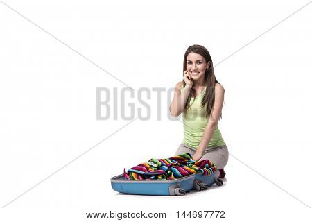 Woman packing preparing for summer vacation isolated on white
