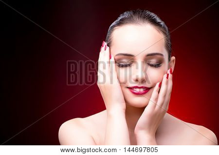 Nice woman against the red background