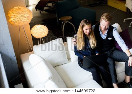 Young Couple On The Sofa