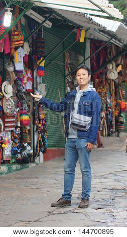 Bogota, Cundinamarca / Colombia - January 20 2016: Asian young tourist at Mount Monserrate craft market in the city of Bogota