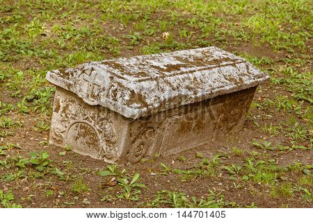 coffin of white stone on the ground