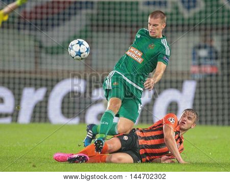VIENNA, AUSTRIA - AUGUST 19, 2015: Srdjan Grahovac (SK Rapid) kicks the ball in an UEFA Champions League qualification game.