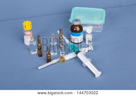 syringes with ampules of drugs