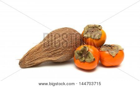 coconut and persimmons isolated on white background close-up. horizontal photo.