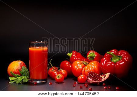 Tomato juice in a glass jar on a black table