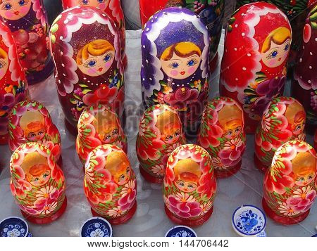 Wooden round painted toy - a national Russian doll a nested doll