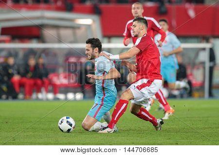 VIENNA, AUSTRIA - MARCH 29, 2016: Aleksandar Dragovic (Austria) and Hakan Calhanoglu (Turkey) fight for the ball in a friendly football game.