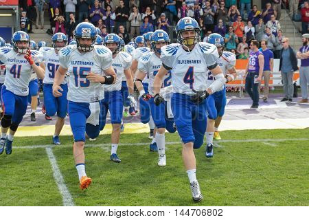 VIENNA, AUSTRIA - APRIL 3, 2016: The team of the Ljubljana Silverhawks runs on the field before a game of the Austrian Football League.