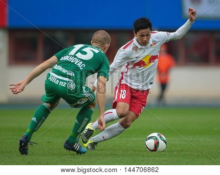 VIENNA, AUSTRIA - OCTOBER 4, 2015: Srdjan Grahovac (SK Rapid) and Takumi Minamino (RB Salzburg) fight for the ball in an Austrian Football League game.