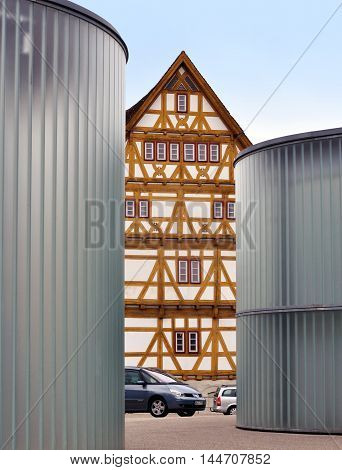 WAIBLINGEN, GERMANY - APRIL 25 2016: The Gallery Stihl in Waiblingen. Contemporary Art Center. Round glass building half-timbered house in between. Baden-Wurttemberg, Germany.