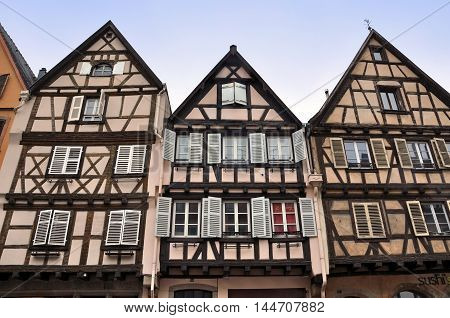 Colmar, France - April 23, 2016: Front view of three old typical half-timbered houses. Colmar, Alsace, France.