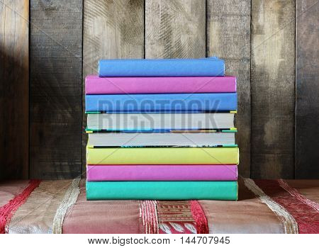 A stack of books in the colored cover on the table. Back to school.