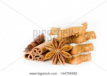 cinnamon cookies with cinnamon sticks isolated on white