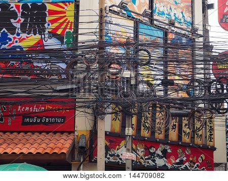 BANGKOK: August 23: The chaos of cables and wires on asok road on August 23, 2016 in Bangkok, Thailand.