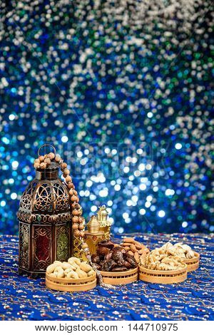 Bright colored Ramadan and Eid Theme Backgrounds with copy space with Perfume Bottles and dates and nuts