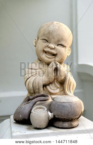 Smiling child monk dolls. The stone craft of monk dolls are the unique and valuable decoration items for the asian lovers.