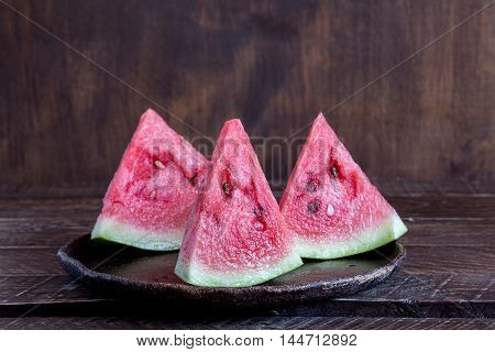 watermelon pieces in a ceramic bowl watermelon on a brown background ceramic bowl with slices of watermelon juicy slices of watermelon