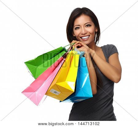 Happy asian girl with shopping bags.