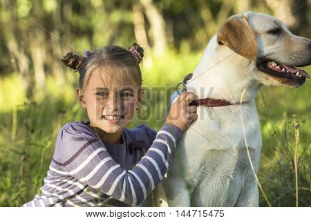 Portrait of a little girl with a dog.
