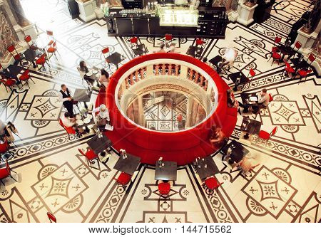VIENNA, AUSTRIA - JUNE 10, 2016: Interior of historical restaurant in Kunsthistorisches Museum with dinning people on June 10, 2016. Musem was opened in 1891. It's among 100 most visited museums worldwide