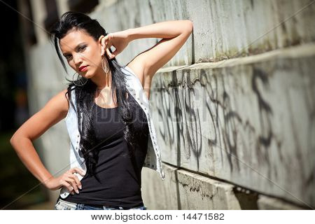 Sexy grunge woman with an urban style outdoors