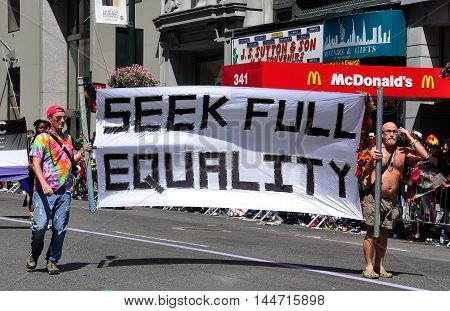 New York City - June 29 2014: Two men carrying a sign seeking full equality at the 2014 Gay Pride Parade on Fifth Avenue