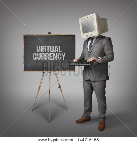 Virtual currency text on blackboard and computer monitor on businessman head